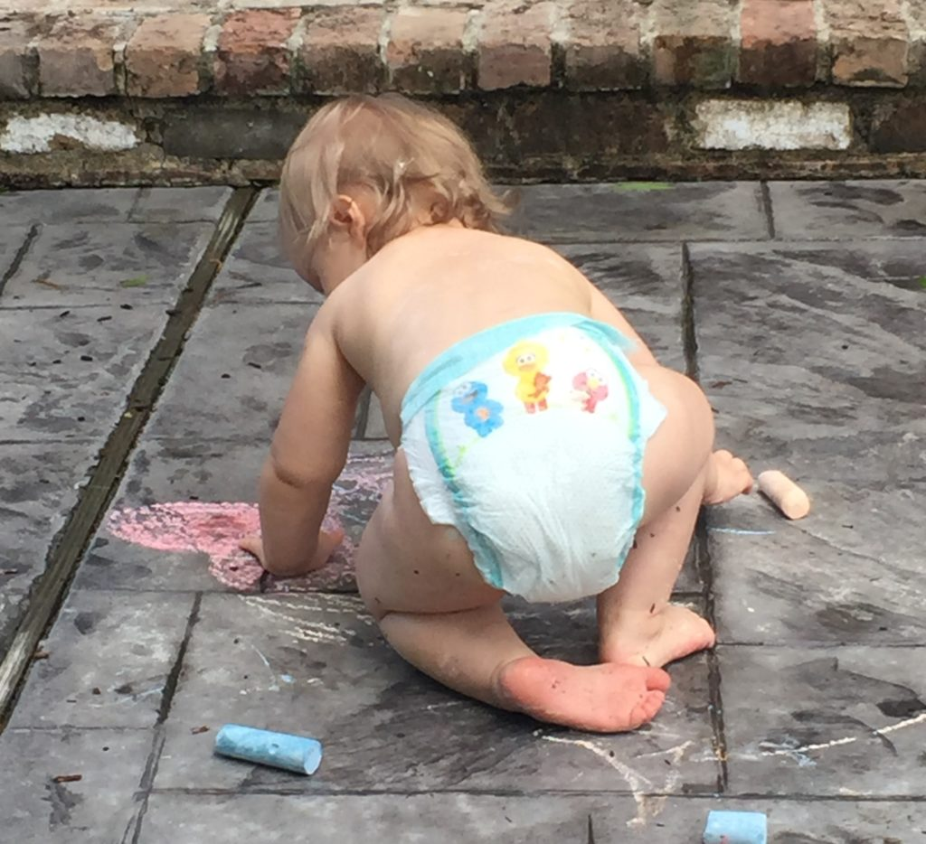 Playing with sidewalk chalk. She doesn't mine getting dirty!